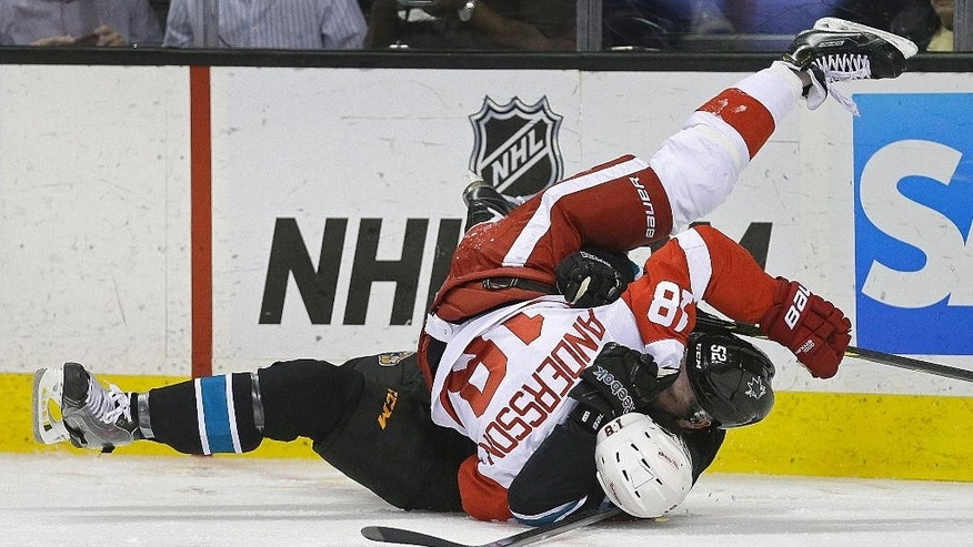 Detroit Red Wings' Joakim Andersson (18) and San Jose Sharks' Matt Irwin wrestle on the ice during the second period of an NHL hockey game Thursday, Feb. 26, 2015, in San Jose, Calif. (AP Photo/Ben Margot)