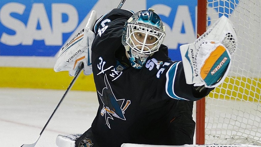 San Jose Sharks goalie Antti Niemi makes a save on a shot from the Detroit Red Wings during the second period of an NHL hockey game Thursday, Feb. 26, 2015, in San Jose, Calif. (AP Photo/Ben Margot)
