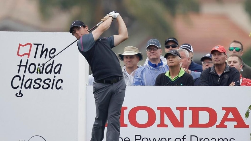 Rory McIlroy  hits from the 16th tee during the second round of the Honda Classic golf tournament, Friday, Feb. 27, 2015 in Palm Beach Gardens, Fla. (AP Photo/Luis M. Alvarez)