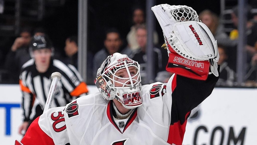 Ottawa Senators goalie Andrew Hammond makes a glove save during the second period of an NHL hockey game against the Los Angeles Kings, Thursday, Feb. 26, 2015, in Los Angeles. (AP Photo/Mark J. Terrill)