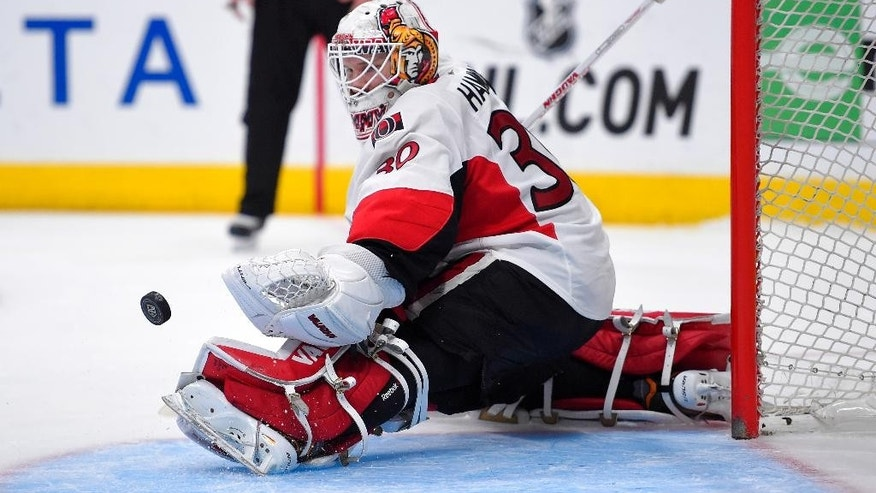 Ottawa Senators goalie Andrew Hammond deflects a shot during the second period of an NHL hockey game against the Los Angeles Kings, Thursday, Feb. 26, 2015, in Los Angeles. (AP Photo/Mark J. Terrill)