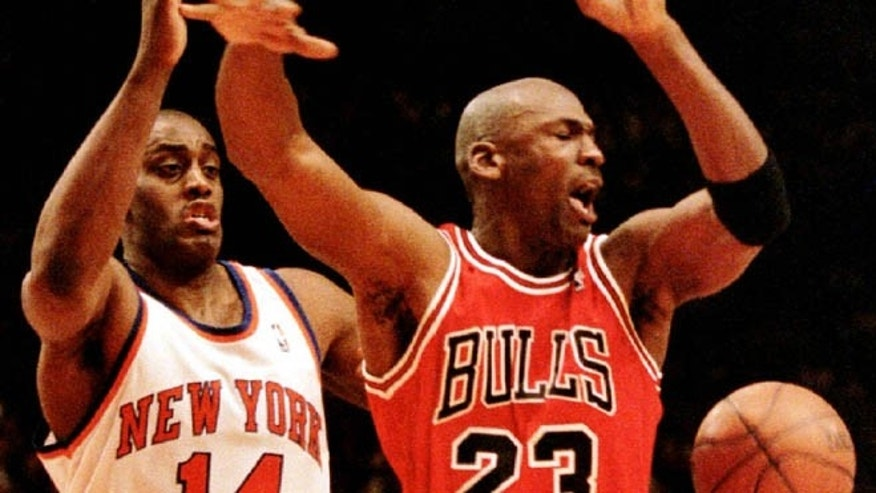 FILE: Michael Jordan has the ball knocked away from him by New York Knicks' forward Anthony Mason during fourth period action in game four of the NBA Eastern Conference Semifinals.