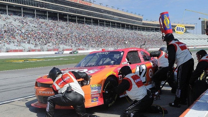 Pit crew members work on Kyle Larson's car during a pit stop in the NASCAR Xfinity series auto race at Atlanta Motor Speedway Saturday, Feb. 28, 2015, in Hampton, Ga.  (AP Photo/John Amis)