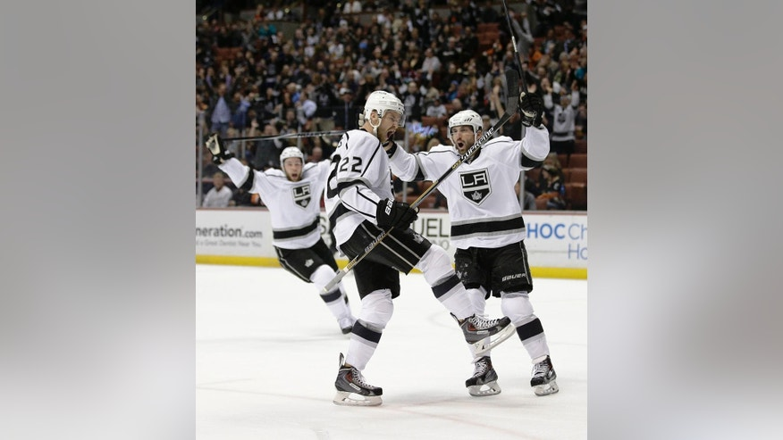 Los Angeles Kings' Trevor Lewis, center, celebrates his goal with Jarret Stoll during the first period of an NHL hockey game against the Anaheim Ducks, Friday, Feb. 27, 2015, in Anaheim, Calif. (AP Photo/Jae C. Hong)