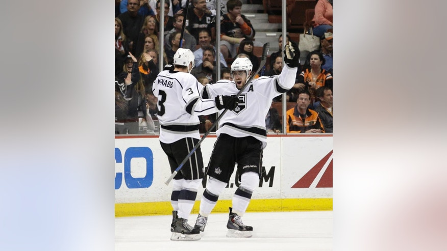 Los Angeles Kings' Brayden McNabb, left, celebrates his goal with Anze Kopitar, of Slovenia, during the second period of an NHL hockey game against the Anaheim Ducks, Friday, Feb. 27, 2015, in Anaheim, Calif. (AP Photo/Jae C. Hong)