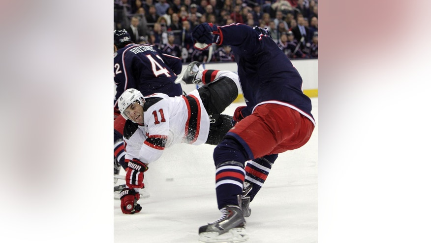 New Jersey Devils' Stephen Gionta, left, and Columbus Blue Jackets' Jack Johnson collide during the first period of an NHL hockey game Saturday, Feb. 28, 2015, in Columbus, Ohio. (AP Photo/Jay LaPrete)