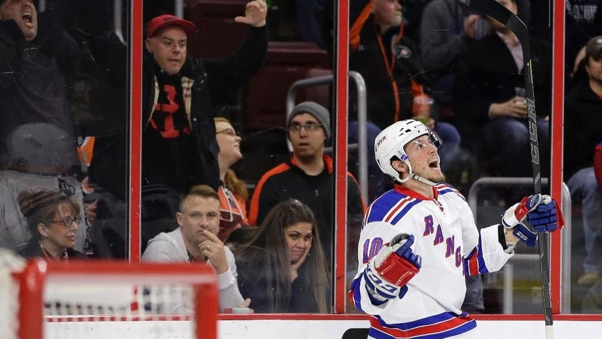 New York Rangers' J.T. Miller celebrates after scoring a goal during the first period of an NHL hockey game against the Philadelphia Flyers, Saturday, Feb. 28, 2015, in Philadelphia. (AP Photo/Matt Slocum)