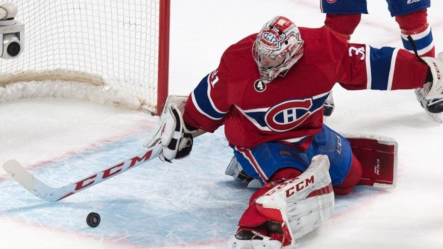 Montreal Canadiens goalie Carey Price stops a rolling puck as they face the Toronto Maple Leafs during second period NHL hockey action Saturday, Feb. 28, 2015 in Montreal. (AP Photo/The Canadian Press, Paul Chiasson)
