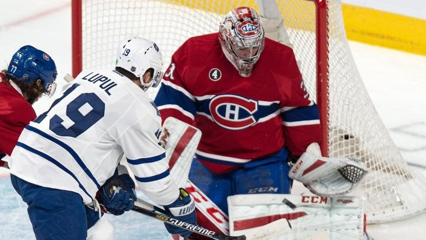 Montreal Canadiens goalie Carey Price makes a save off Toronto Maple Leafs' Joffrey Lupul during first period NHL hockey action Saturday, Feb. 28, 2015 in Montreal. (AP Photo/The Canadian Press, Paul Chiasson)