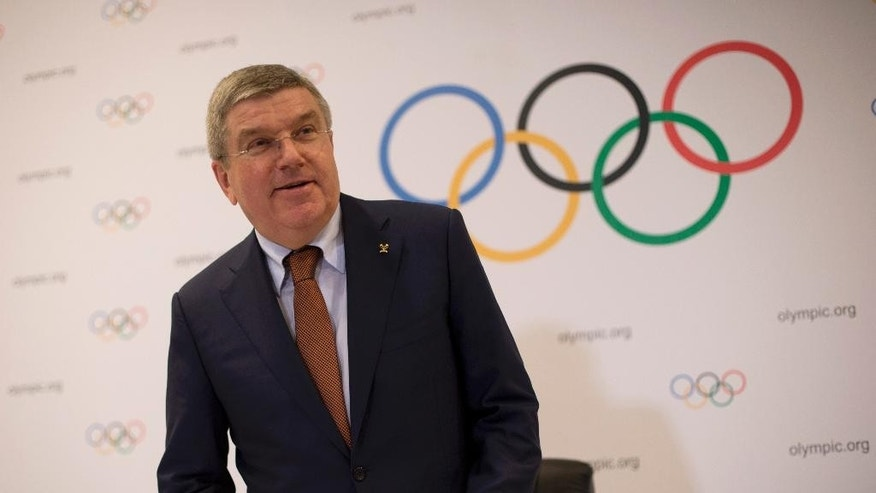 International Olympic Committee President Thomas Bach arrives to a press conference during a IOC executive board meeting in Rio de Janeiro, Brazil, Saturday, Feb. 28, 2015. IOC officials have been in Rio this week monitoring progress on the games. South America's first Olympics open Aug. 5. 2016. (AP Photo/Silvia Izquierdo)