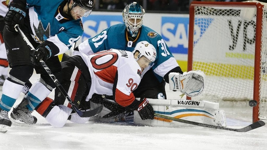 Ottawa Senators' Alex Chiasson (90) takes a shot against San Jose Sharks goalie Antti Niemi (31) as Sharks' Marc-Edouard Vlasic, left, defends during the second period of an NHL hockey game Saturday, Feb. 28, 2015, in San Jose, Calif. (AP Photo/Ben Margot)