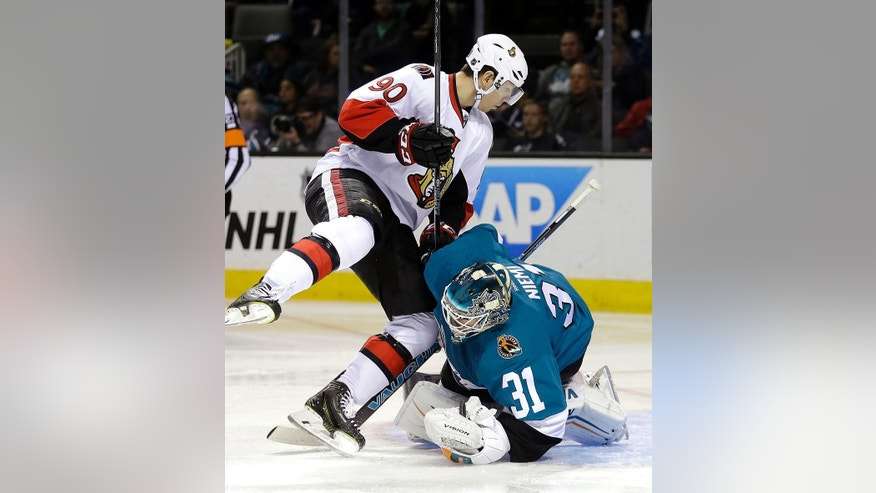 Ottawa Senators' Alex Chiasson, left, collides with San Jose Sharks goalie Antti Niemi (31) during the second period of an NHL hockey game Saturday, Feb. 28, 2015, in San Jose, Calif. (AP Photo/Ben Margot)