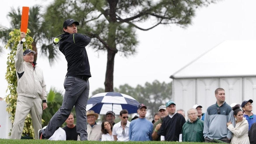 Rory McIlroy, of Northern Ireland, tees off  at the fourth hole during the second round of the Honda Classic golf tournament, Friday, Feb. 27, 2015 in Palm Beach Gardens, Fla. (AP Photo/Alan Diaz)