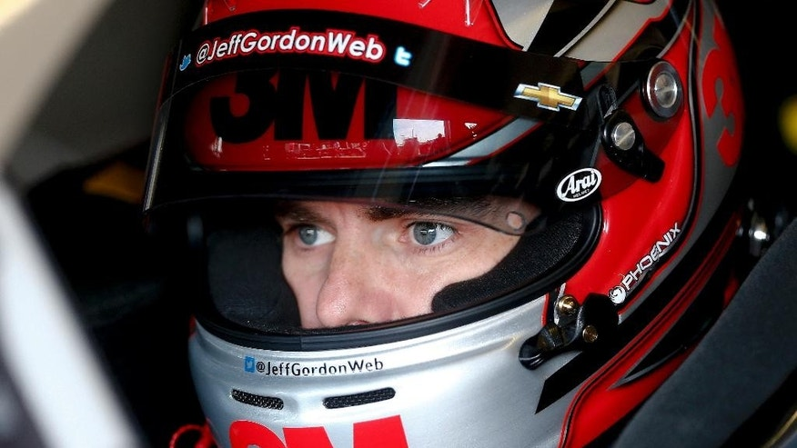 Driver Jeff Gordon waits to leaves the garage for practice for Sunday's NASCAR Sprint Cup Series auto race Saturday, Feb. 28, 2015, in Hampton, Ga.  (AP Photo/John Bazemore)