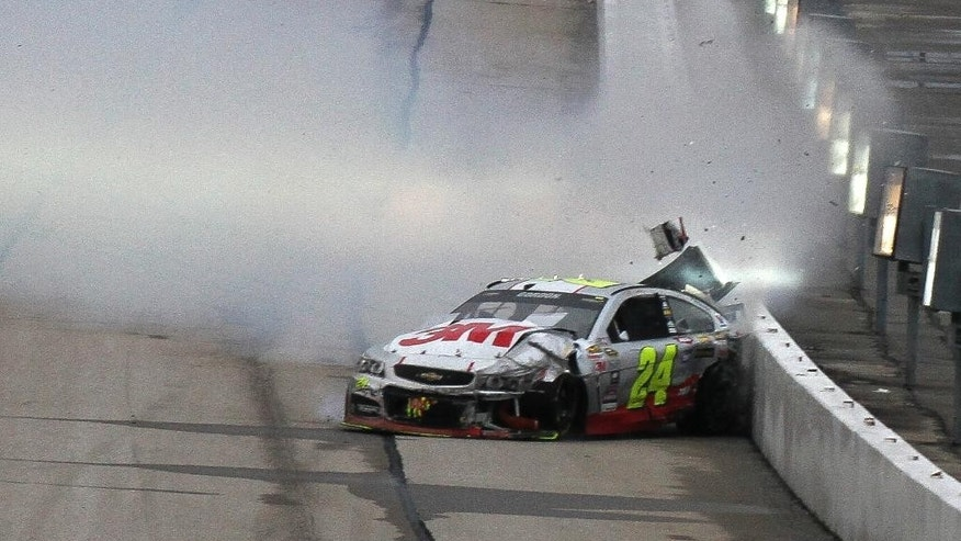 Jeff Gordon (24) hits the wall during the NASCAR Sprint Cup series auto race at Atlanta Motor Speedway, Sunday, March 1, 2015, in Hampton, Ga. (AP Photo/Russell Norris)