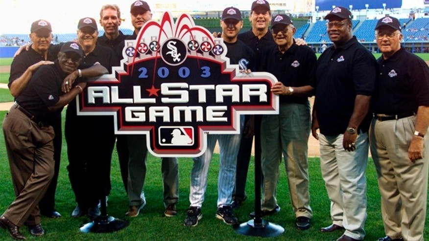 Aug. 7, 2002: Past and present Chicago White Sox All-Stars, from left, Bill Skowron, Minnie Minoso (leaning on sign), Bill Melton, Ed Farmer, Ron Kittle,Mark Buehrle, Carlton Fisk, Chico Carrasquel, Carlos May and BillyPierce pose for a photo in Chicago's Comiskey Park, with the logo for the 2003 All-Star Game, which is scheduled to beplayed at Comiskey Park. (Reuters)