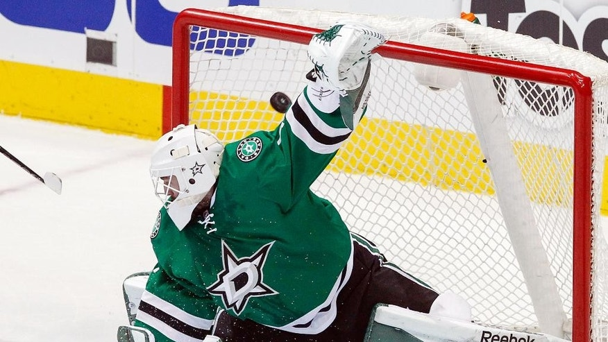 Dallas Stars goalie Jhonas Enroth (1) fails to stop a goal by Anaheim Ducks right wing Corey Perry in the first period of an NHL hockey game, Sunday, March 1, 2015, in Dallas. (AP Photo/Tim Sharp)