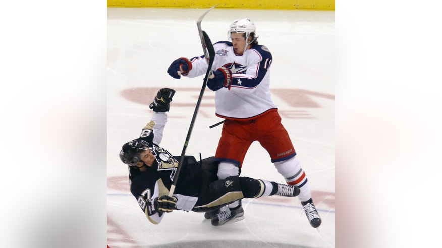 Pittsburgh Penguins' Sidney Crosby (87) is checked by Columbus Blue Jackets' Ryan Johansen (19) in the first period of an NHL hockey game, Sunday, March 1, 2015, in Pittsburgh. (AP Photo/Keith Srakocic)