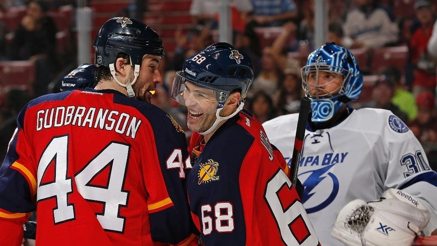 Florida Panthers forward Jaromir Jagr (68) smiles after getting an assist on a goal by forward Aleksander Barkov (not shown) during the second period of an NHL hockey game against the Tampa Bay Lightning, Sunday, March 1, 2015, in Sunrise, Fla. (AP Photo/Joel Auerbach)