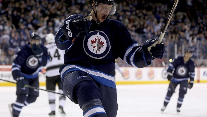 Winnipeg Jets' Tyler Myers  celebrates after scoring against the Los Angeles Kings' during second period NHL hockey action in Winnipeg, Manitoba, Sunday, March 1, 2015. (AP Photo/The Canadian Press, Trevor Hagan)