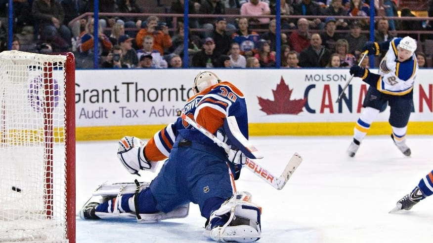 St. Louis Blues' Dmitrij Jaskin (23) scores a goal on Edmonton Oilers goalie Ben Scrivens (30) during first period NHL hockey action in Edmonton, Alta., on Saturday February 28, 2015. THE CANADIAN PRESS/Jason Franson