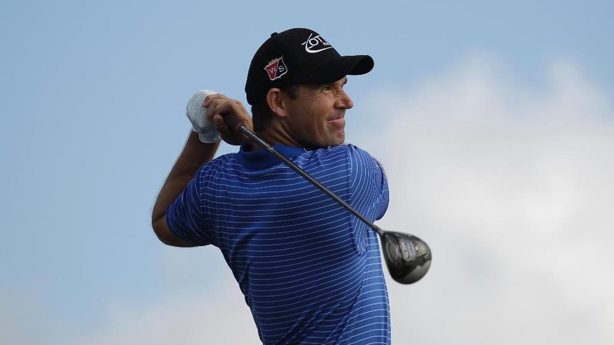 Padraig Harrington hits from the 13th tee during the final round of the Honda Classic golf tournament, Monday, March 2,  2015, in Palm Beach Gardens, Fla. Harrington defeated Daniel Berger in a two hole playoff. (AP Photo/Luis M. Alvarez)