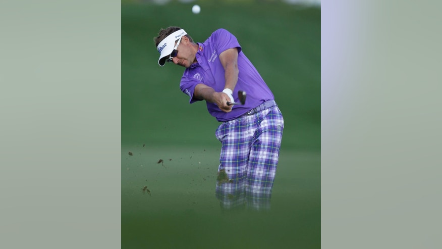 Ian Poulter hits from the first fairway during the final round of the Honda Classic golf tournament, Sunday, March 1, 2015, in Palm Beach Gardens, Fla. (AP Photo/Luis M. Alvarez)