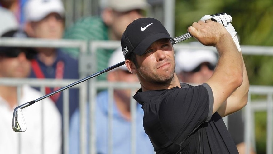 Paul Casey hits from the first tee during the final round of the Honda Classic golf tournament, Sunday, March 1,  2015, in Palm Beach Gardens, Fla. (AP Photo/Luis M. Alvarez)