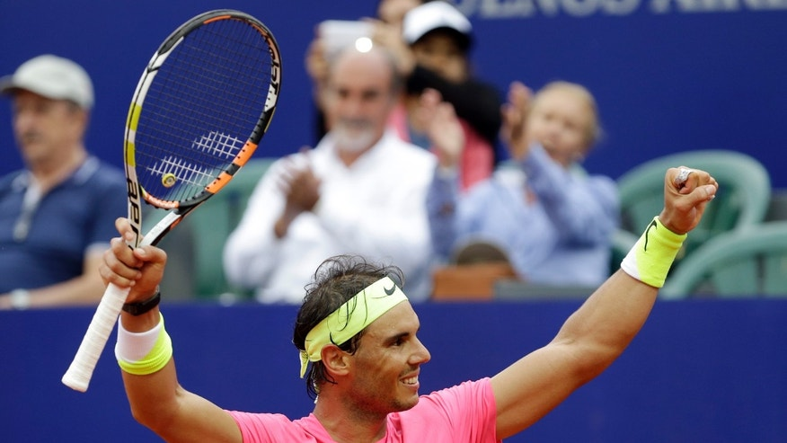 Rafael Nadal of Spain celebrates winning the final tennis match at the ATP Argentina Open against Juan Monaco of Argentina in Buenos Aires, Argentina, Sunday, March 1, 2015. Nadal won 6-4, 6-1. (AP Photo/Victor R. Caivano)