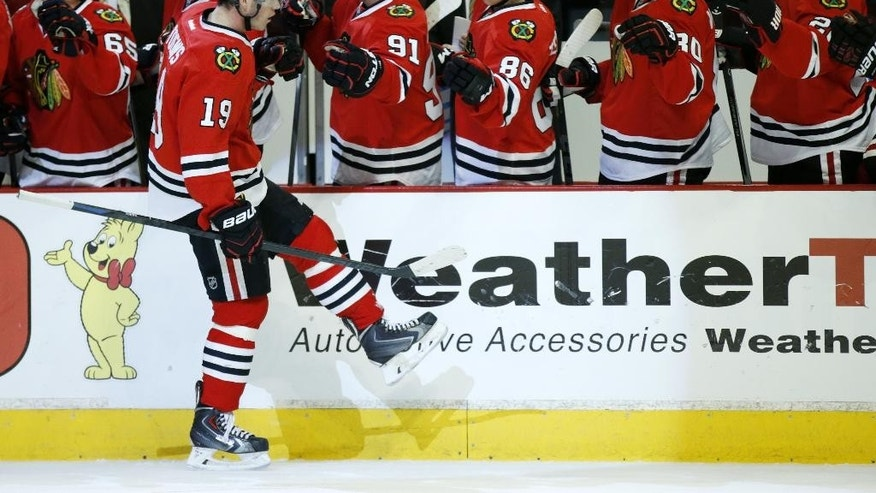 Chicago Blackhawks center Jonathan Toews (19) celebrates his goal against the Carolina Hurricanes during the first period of an NHL hockey game Monday, March 2, 2015, in Chicago. (AP Photo/Andrew A. Nelles)