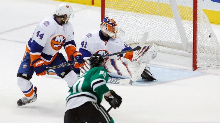 New York Islanders goalie Jaroslav Halak (41) and defenseman Calvin de Haan (44) watch the puck hit the back of the net to end the game on a goal from Dallas Stars center Cody Eakin (20) during an overtime period of an NHL hockey game Tuesday, March 3, 2015 in Dallas. Dallas won the game 3-2.  (AP Photo/Tim Sharp)