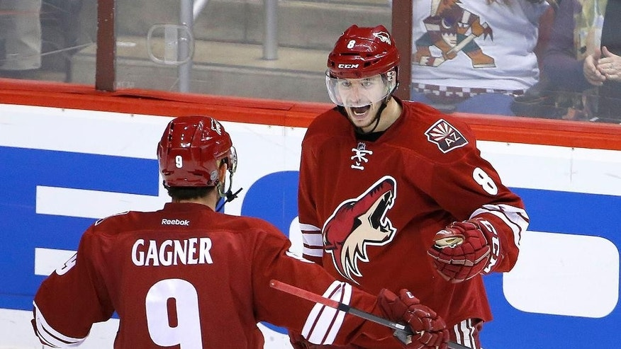 Arizona Coyotes' Tobias Rieder (8), of Germany, celebrates his goal against the Anaheim Ducks with Sam Gagner (9) during the second period of an NHL hockey game Tuesday, March 3, 2015, in Glendale, Ariz. (AP Photo/Ross D. Franklin)