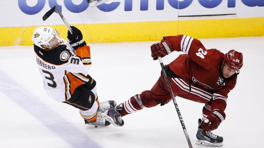 Arizona Coyotes' Kyle Chipchura (24) gets tangled up with Anaheim Ducks' Jakob Silfverberg (33), of Sweden, during the second period of an NHL hockey game Tuesday, March 3, 2015, in Glendale, Ariz. (AP Photo/Ross D. Franklin)