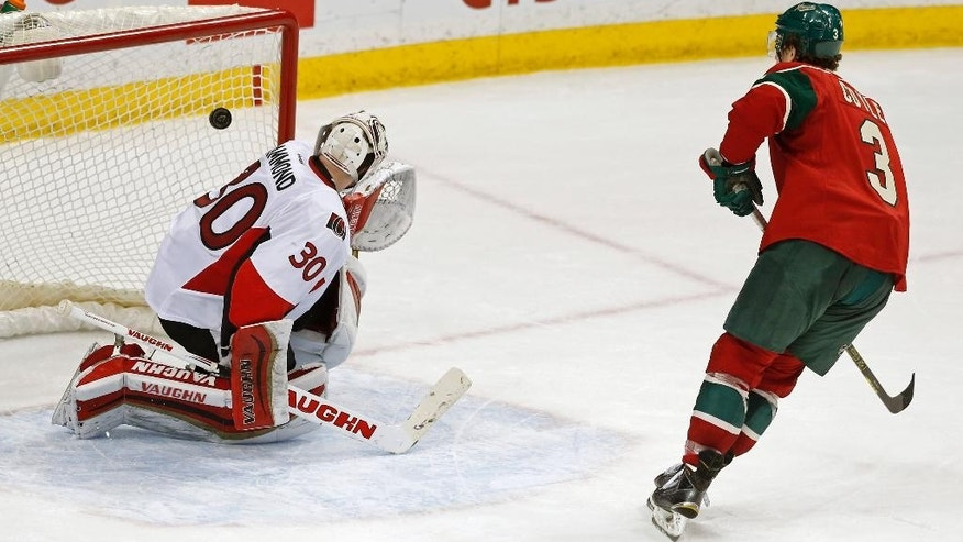 Minnesota Wild's Charlie Coyle, right, makes the winning shot in the shootout past Ottawa Senators goalie Andrew Hammond of Sweden in an NHL hockey game, Tuesday, March 3, 2015, in St. Paul, Minn. The Wild won 3-2. (AP Photo/Jim Mone)