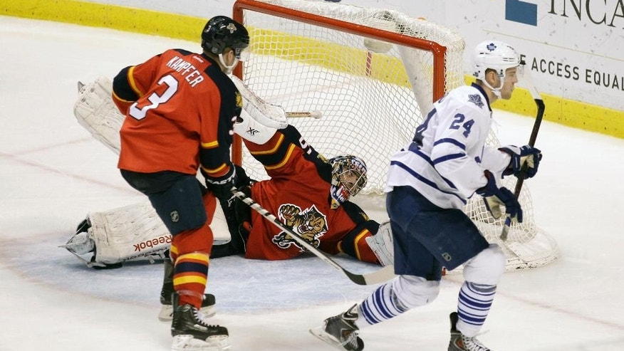 Toronto Maple Leafs' Peter Holland (24) scores the game winning goal against Florida Panthers goalie Al Montoya as Florida Panthers' Steven Kampfer (3) defends during the third period of an NHL hockey game, Tuesday, March 3, 2015, in Sunrise, Fla. The Maple Leafs won 3-2.(AP Photo/Luis M. Alvarez)