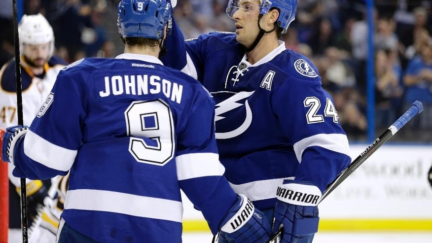 Tampa Bay Lightning right wing Ryan Callahan (24) celebrates with center Tyler Johnson (9) after scoring against the Buffalo Sabres during the second period of an NHL hockey game Tuesday, March 3, 2015, in Tampa, Fla. (AP Photo/Chris O'Meara)