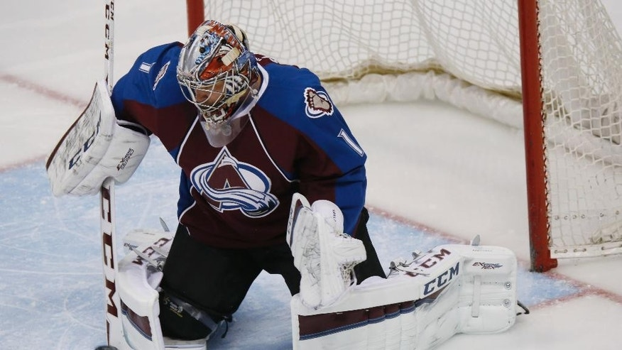 Colorado Avalanche goalie Semyon Varlamov, of Russia, makes a stick-save of a shot against the Pittsburgh Penguins in the first period of an NHL hockey game Wednesday, March 4, 2015, in Denver. (AP Photo/David Zalubowski)