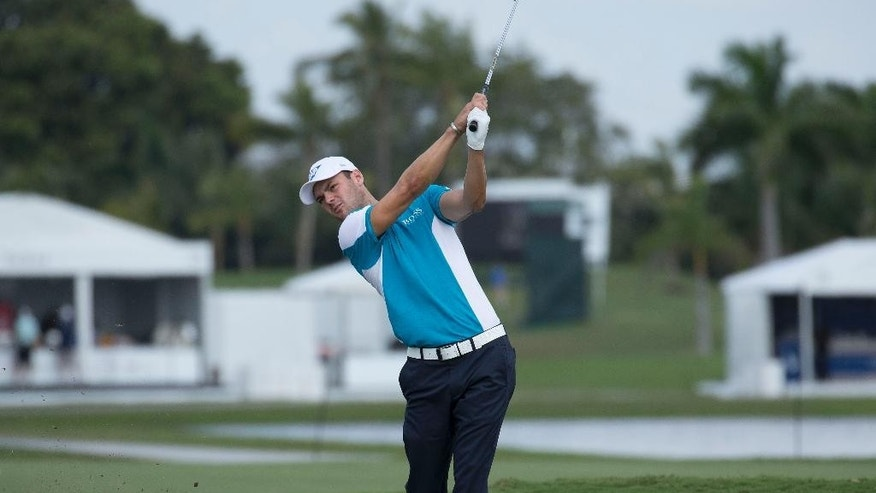 Martin Kaymer hits on the fourth fairway during a practice round for the Cadillac Championship golf tournament in Doral, Fla., Wednesday, March 4, 2015. (AP/J Pat Carter)