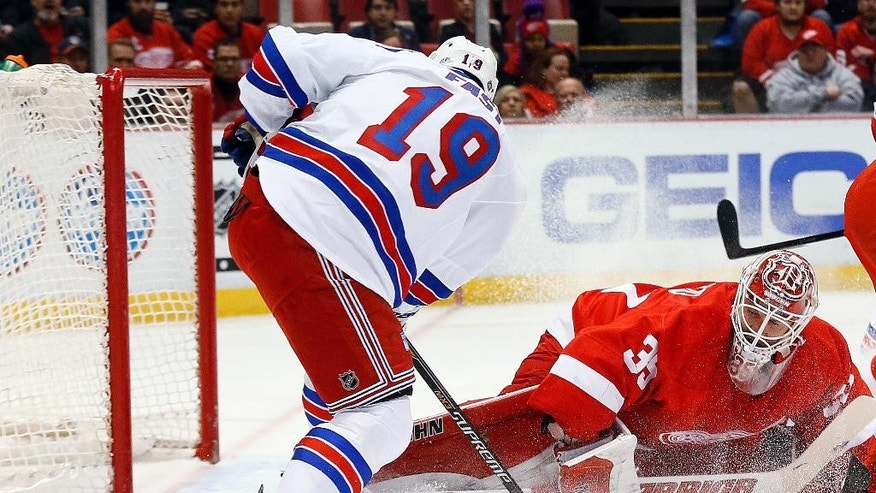 Detroit Red Wings goalie Jimmy Howard (35) stops a shot by New York Rangers right wing Jesper Fast (19) during the first period of an NHL hockey game in Detroit on Wednesday, March 4, 2015. (AP Photo/Paul Sancya)