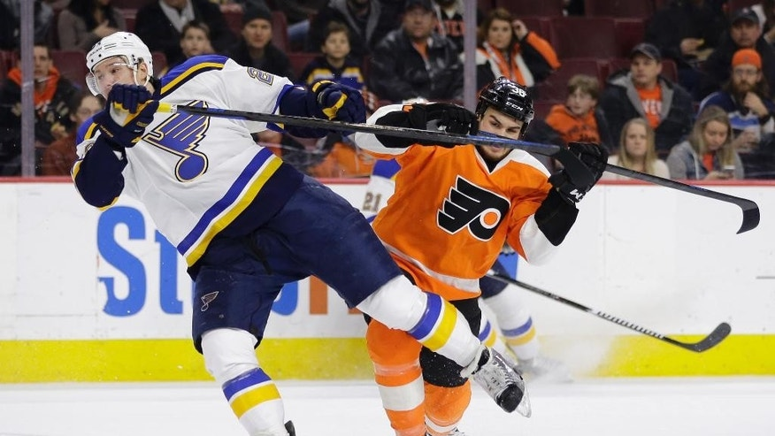Philadelphia Flyers' Zac Rinaldo, right, collides with St. Louis Blues' Dmitrij Jaskin, of Russia, during the second period of an NHL hockey game, Thursday, March 5, 2015, in Philadelphia. (AP Photo/Matt Slocum)