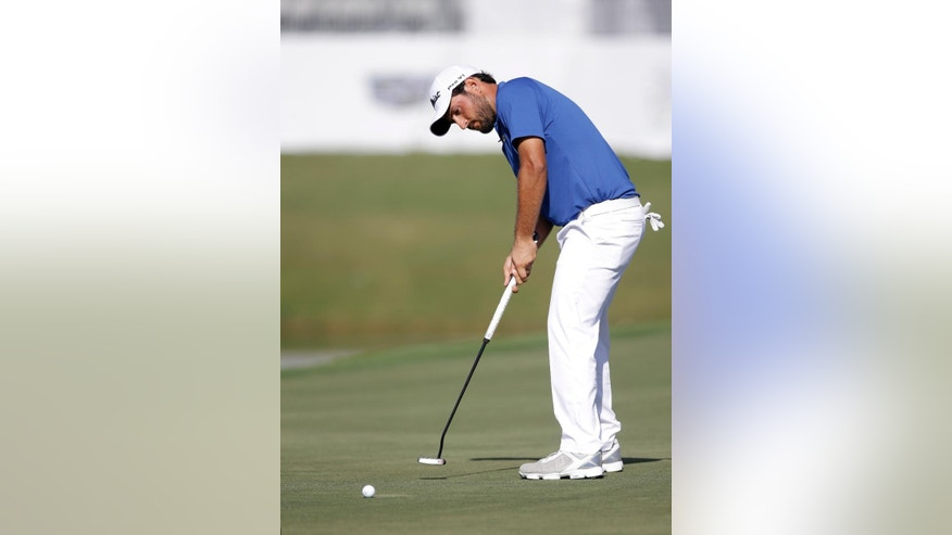 Alexander Levy of France putts on the 18th hole during the first round of the Cadillac Championship golf tournament, Thursday, March 5, 2015, in Doral, Fla. (AP Photo/Wilfredo Lee)