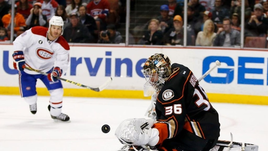 Anaheim Ducks goalie John Gibson, right, blocks a shot by Montreal Canadiens right wing Brandon Prust during the first period of an NHL hockey game in Anaheim, Calif., Wednesday, March 4, 2015. (AP Photo/Chris Carlson)