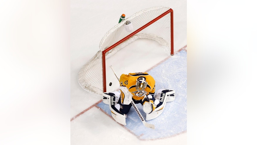 A shot by New York Islanders defenseman Nick Leddy gets past Nashville Predators goalie Pekka Rinne, of Finland, for a goal in the third period of an NHL hockey game, Thursday, March 5, 2015, in Nashville, Tenn. (AP Photo/Mark Humphrey)