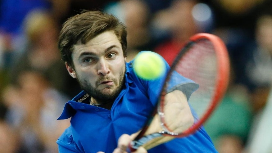France's Gilles Simon hits a backhand against Germany's Jan-Lennard Struff during a first round tennis Davis Cup match between Germany and France in Frankfurt, Germany, Friday, March 6, 2015. (AP Photo/Michael Probst)