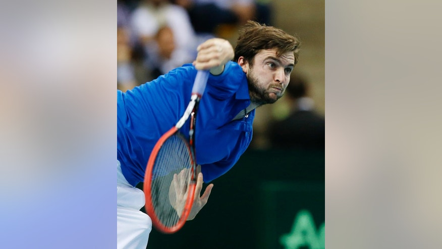 France's Gilles Simon serves against Germany's Jan-Lennard Struff during a first round tennis Davis Cup match between Germany and France in Frankfurt, Germany, Friday, March 6, 2015. (AP Photo/Michael Probst)