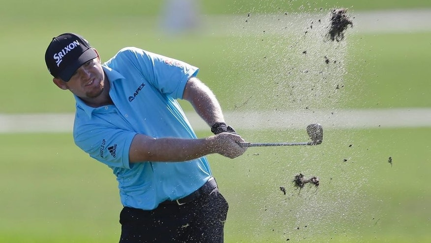 J.B. Holmes hits on the second fairway during the first round of the Cadillac Championship golf tournament, Thursday, March 5, 2015, in Doral, Fla. (AP Photo/Wilfredo Lee)