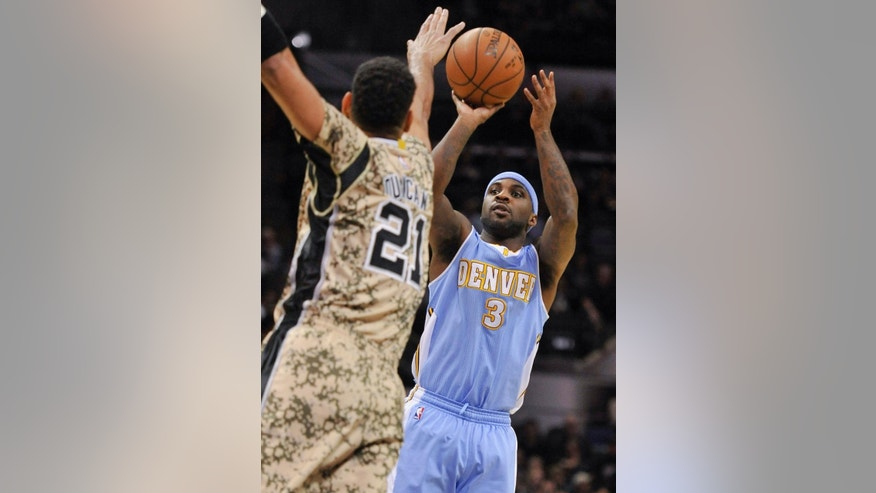 Denver Nuggets guard Ty Lawson, right, shoots against San Antonio Spurs forward Tim Duncan during the first half of an NBA basketball game, Friday, March 6, 2015, in San Antonio. (AP Photo/Darren Abate)