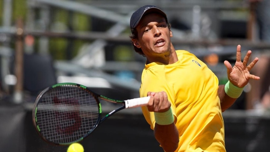 Joao Souza, of Brazil,  returns the ball against Argentina's Carlos Berlocq  during a Davis Cup singles tennis match in Buenos Aires, Argentina, Friday, March 6, 2015.(AP Photo/Natacha Pisarenko)