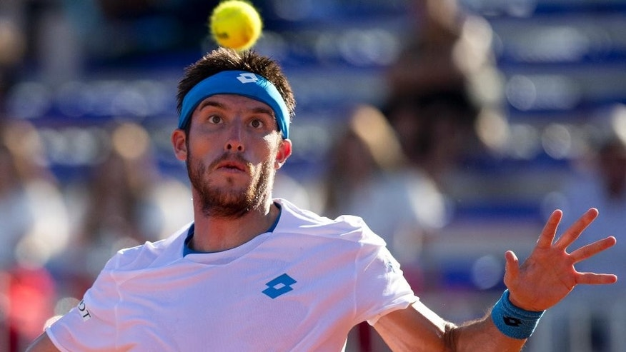 Argentina's Leonardo Mayer eyes the ball during a Davis Cup singles tennis match against Brazil's Thomaz Bellucci in Buenos Aires, Argentina, Friday, March 6, 2015. (AP Photo/Natacha Pisarenko)