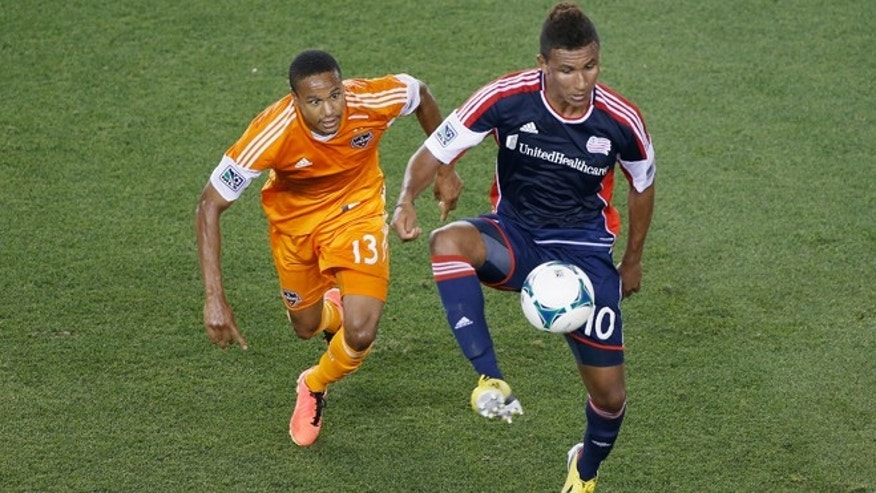 HOUSTON, TX - MAY 18:  Juan Agudelo #10 of the New England Revolution plays a ball in the second half against Ricardo Clark #13 of the Houston Dynamo at BBVA Compass Stadium on May 18, 2013 in Houston, Texas.  (Photo by Scott Halleran/Getty Images)